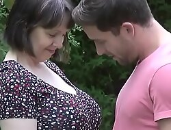 Mom And Son Enjoy Pile up In Natural Surroundings Outdoors